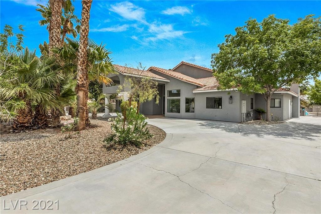 This gorgeous custom home has spared no expense! Walk into to a large open concept space, kitchen includes 2 refrigerators, 2 dishwashers a large island and many extras, 6 bedrooms each with their own full custom bath, head outside to a custom pool with two jacuzzi's, fire pit, fruit trees, basketball court and plenty of space to add to this 31,799sqft lot! This home is truly one of a kind and move-in ready!