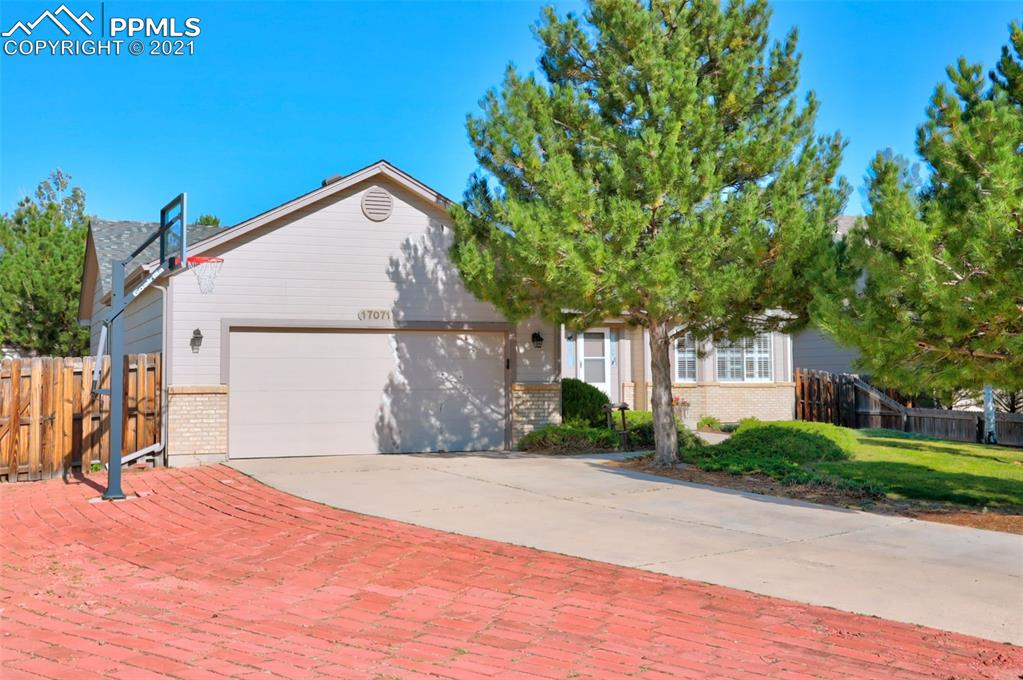 Rare ranch gem in the beautiful Santa Fe Trails neighborhood! You're in close proximity to parks and trails, you have easy access to I-25, and the stunning Mount Herman serves as the backdrop for this awesome area. The exterior of this home has been meticulously maintained over the years. The roof is also newer having been replaced in 2016. The lot is one of the biggest in the neighborhood at over a quarter of an acre!  Walking through the front door you'll immediately notice how inviting this space is. To the left you have your dining area. Straight ahead, the family room features a gas fireplace which really cozy's up the room. There's also 2 skylights which add a ton of natural light. The family room flows right into the kitchen which has an island w/ bar seating and an eat-in area where you can fit another dining table. What you'll notice about the eat-in dining area and the rest of the home is that all of the windows are treated w/ plantation shutters, a HUGE plus. Heading through the glass sliders in the kitchen, you'll see that there's a lot to love about the super spacious backyard; Mature trees, a freshly painted huge deck, and a shed that stays w/ the home.  Going back into the home, just beyond the family room are your Two secondary bedrooms. There's also a full bathroom that has been completely remodeled. On the opposite side of the home, as you head towards the primary bedroom, you'll pass the garage entryway which doubles as the laundry room. Moving on to the huge Master Bedroom, you are then greeted with vaulted ceilings inside. The Master Bathroom has also been upgraded and features a separate tub and shower and a nice-sized walk in closet. Overall, this is a beautiful home in a beautiful neighborhood, you don't want to miss out!!