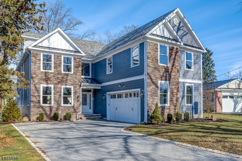 One-Of-A-Kind custom Center Hall Colonial, new construction nestled on a highly sought after oval. Featuring all the bells & whistles across 5,800 +/-SQ FT of finished living space. The amazing Chef's kitchen w/dual center islands, quartz C/T, top of the line S/S Monogram appliances & Butler's pantry is open to a magnificent great room w/18' ceiling & gas frplce. Formal DR, LR, powder room & laundry room w/dog shower complete the 1st level. The 2nd level features a master suite w/His & Her WIC's & luxurious private bath, BR w/en suite, plus two more BR's & a main bath. Finished 3rd level & bsmt w/large rec room & full bath. Timberline roof, Andersen windows, 5 zone heat & air, partial HardiePlank exterior, paved driveway, two car garage & so much more! Near houses of worship & legendary Baltusrol Golf Club.