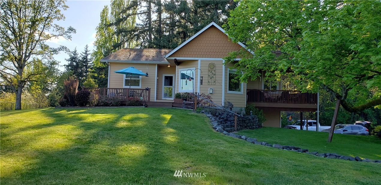 Amazing 2 bedroom 2 bath accessible home  on .75 acre lot, with 5 car garage, beautiful territorial view. Elevator from garage to main living area. Great room has oversized windows that overlook the property and is open to kitchen and dining room. Large master with large walk in closet, French drs to den/nursery, beautiful tile shower, heated tile floors. Laundry on main floor.  The garage is as big as home. Beautifully manicured lot w/RV parking. This is a must see!