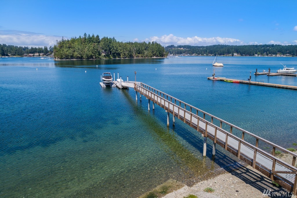 """Western facing, low bank, .71 acre (incl two buildable parcels), stunning sunsets & new 184 ft shared dock, all on the sweetest lane in town, surrounded by $2+ mil homes!  This cabin, the outbuildings, and the boat """"carport"""" were loved by one family since 1924, and now it's your turn! Cabin, carport, shop, and boat """"carport"""" may all be teardowns, but they are located close to the water, so are of huge value in remodeling! Bring your plans and your builder to recreate a stunning legacy property!"""