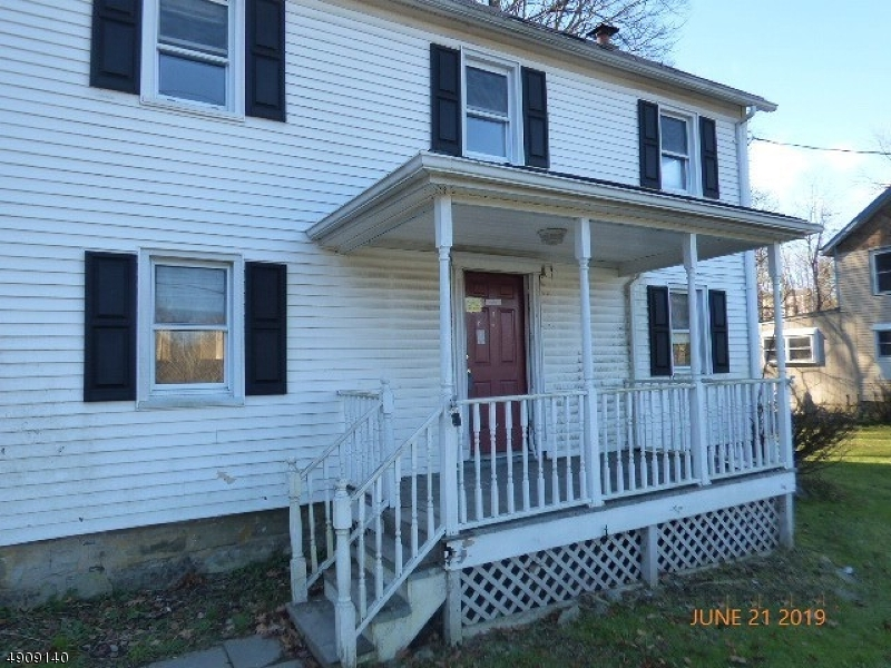Colonial home in need of total renovation. Generous sized rooms, kitchen opens to dining area and an enclosed porch. Sold AS IS no repairs  will be done. All inspections CO and water are the buyers responsibility.  Utilities are not on.