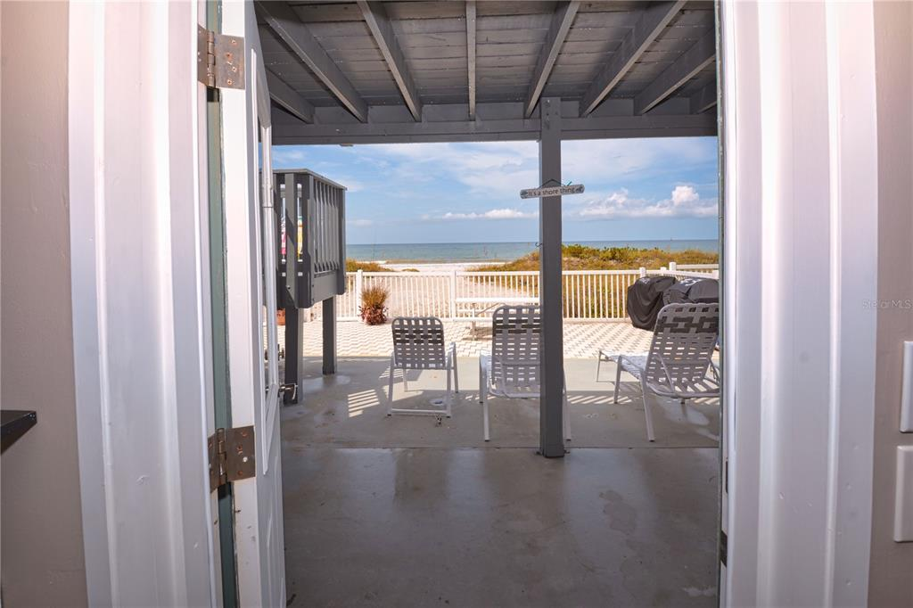 ON THE SAND IN INDIAN ROCKS BEACH! This updated 1 bedroom 1 bath ground floor condo on the beach has lots to offer. If you need a get away spot or want to air b&b, 1 week rentals allowed., this unit comes fully furnished so start using it today! Kitchen offers, new wood cabinets and counter tops, can lights. Bath has new shower, and vanity, updated electric, hurricane shutters for all windows and door, large walk in closet.  This unit offers a low maintenance fee. Enjoy your morning coffee on patio or a glass of wine at sunset. Condo building roof and electrical is approx 4 years old. Small pets allowed for owners up to 35 lb. Enjoy the beach life!