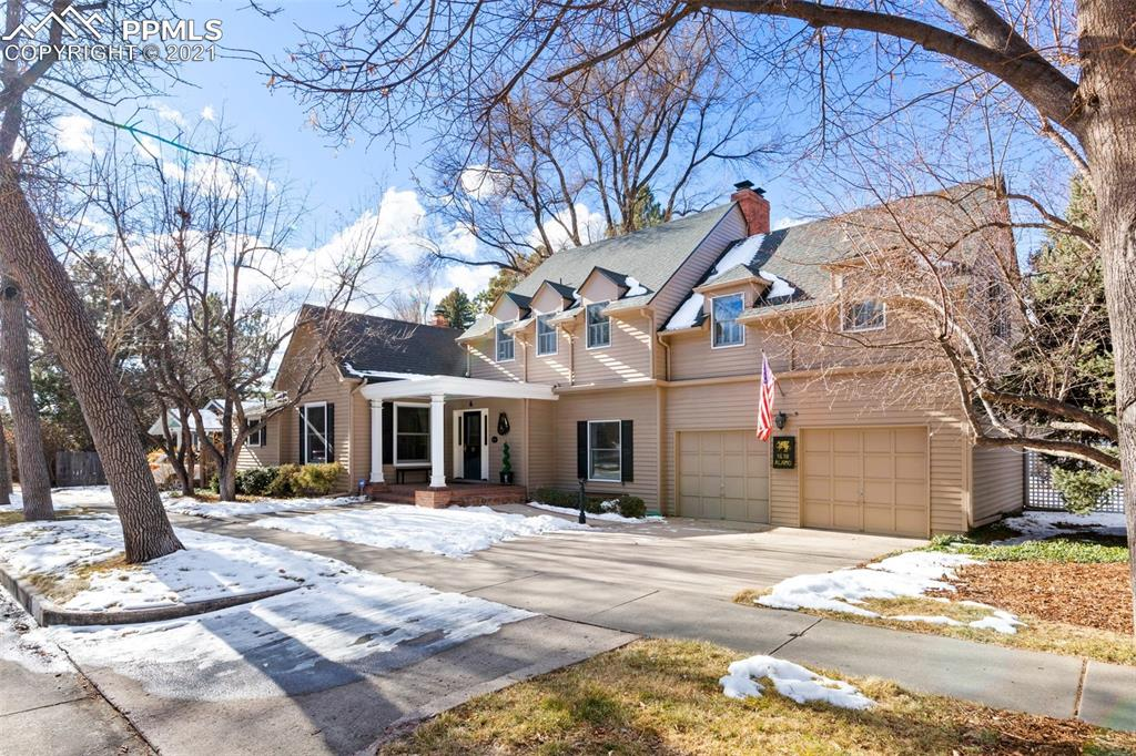 Welcome home to this beautiful turn of the century home in Historic Old North End.  Within walking distance you will find Colorado Springs's thriving downtown, Colorado College, Museums and the Pikes Peak Center.  Within a 5 minute walk is Monument Valley Park and the New Sante Fe Regional Trail.  Surround yourself with the old world charm of wide streets, architecturally diverse homes and lush gardens.  This family has owned this home for 50 years, and has maintained the property with love and perfection. Hardwood floors beckon you throughout the home, accompanied by timeless wide trim, crown molding and luxury wall paper.   Enter into a large formal living room with great windows for natural light and a wood burning fireplace.  A large formal dining room off the kitchen is where memories are made.  The kitchen is very large and open, with a walk out to the back yard patio space.  The owner has a love for gardening and in the summer the backyard is a true oasis, landscaped for color year-round.  A library completes the main floor, with built in book shelves and a fireplace.  If you are working from home, there truly is not a better setting than this library.  Retreat to the master suite upstairs where you will be greeted with another wood burning fireplace, views of Pikes Peak and spacious master bathroom.  The master has his/hers closets which is a perk in an older home.  2 more bedrooms and a full bathroom complete the upstairs space.  The basement offers an additional bedroom or recreation room, with laundry and a half bath.  A hidden basement is off the family room/kitchen, this area is great storage.  Between the charming, yet updated interior spaces and the old world community surrounding it, this home leaves little to be desired!