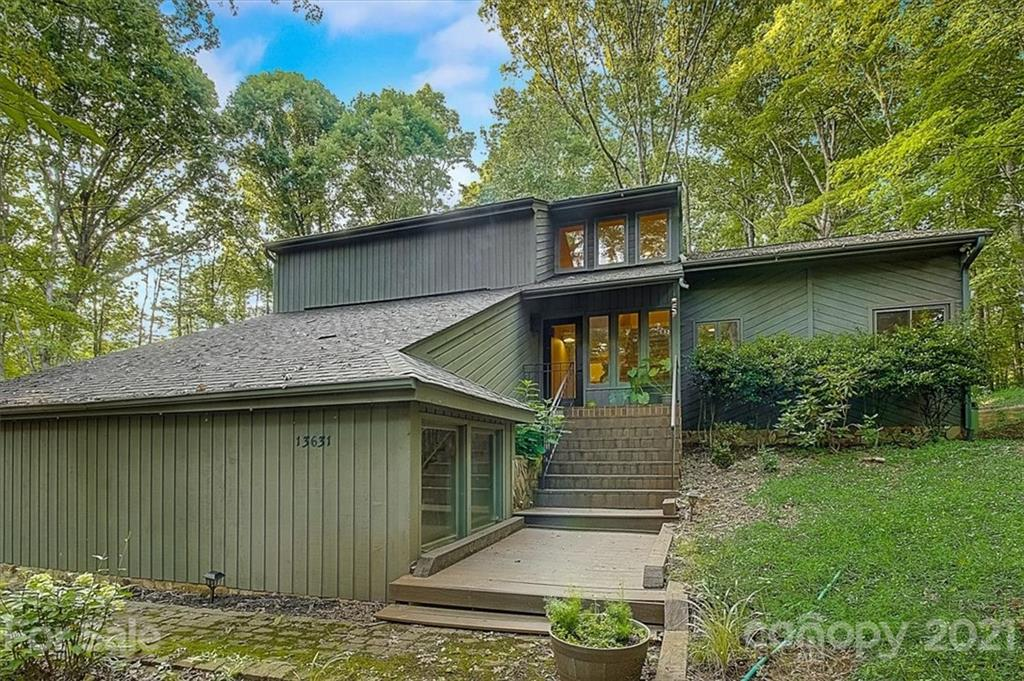 This home is a gorgeous contemporary home. Imagine your own private world that is a stone's throw from the lake. It feels like a storybook come to life. You have a deeded boat slip and your own backyard trail. You have so many outdoor spaces & decks, your home feels as if it is a part of nature. Daily drinks around the fire pit will call you. You feel miles away from everything loud and busy, yet you are close to all things you need. Come tour this private oasis. You will fall in love and want to move in tomorrow. I know I do.