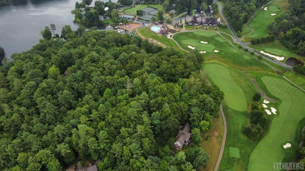 This is a great chance for you to purchase two lots with golf course views located in the pristine Lake Toxaway Estates. After clearing,  these parcels would have great views of hole 2 and hole 8 on the Fazio-designed executive golf course. These two gently-sloping wooded lots are only a short stroll or cart drive away from the Clubhouse and pool, Marina, Tennis and Croquet courts, as well as the historic Greystone Inn. Also, this property has deeded water access to Lake Toxaway, the largest private lake in North Carolina. Some amenities are only included with club membership, club membership is not included.