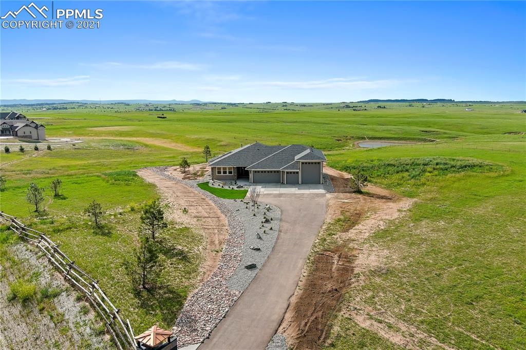 This home is in the sought after Flying Horse North golf community and resort.  The home is  gorgeous and built in 2019 and is barely lived in.  It is literally like new throughout.  It is a 5,355 sq. ft. Ranch home and located on a large 5 acre corner lot. Newly landscaped, the home features an open concept floor plan, a luxurious kitchen with formal dining room.  The 6 car garage is heated and one of the bays is large for your BIG RV.  The views from the rear of the home are of open space and very private.  The main level living room features a stone fireplace with built-ins.  There are 6 bathrooms and 5 bedrooms with a 5-piece master suite, two more bedrooms upstairs each with their own separate bathroom. Finished basement has 9 ft ceilings and two bedrooms with a shared bath, and a 1/2 bath, and a large family room / rec room with a wet bar. As an extra the home has tons of storage. Beautiful views and quality home! Quick Move-in!n New sod will be laid July 19th. Make sure to view the 3d walkthrough.