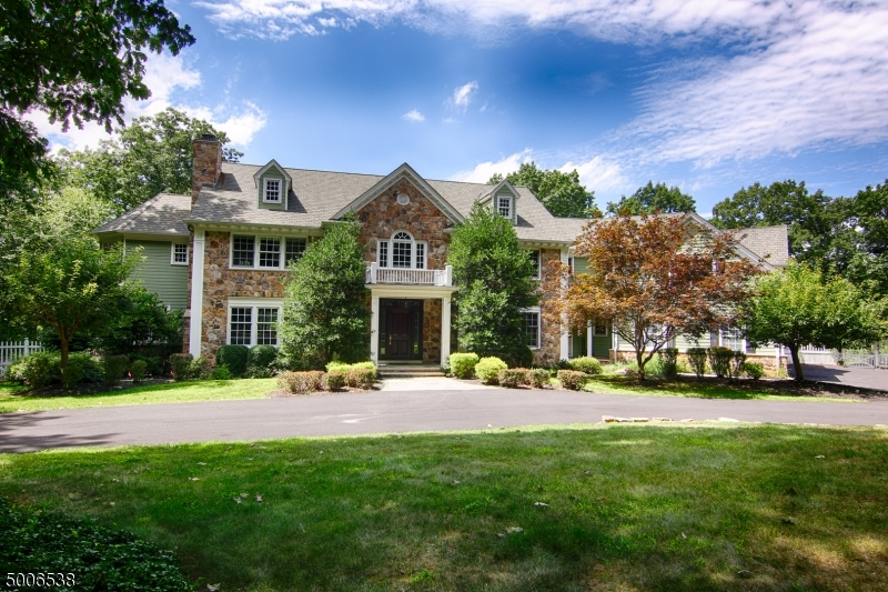 Magnificent estate beautifully positioned on a professionally landscaped 5.6-acre, wooded lot on a quiet cul-de-sac!  Thoughtfully designed with all the amenities contemporary homeowners desire! 3 fireplaces, wood floors, and 9ft ceilings. Expansive Gourmet Kitchen with adjoining Breakfast Rm easily services the Living Rm, formal Dining Rm, and the inspiring Family Rm with cathedral ceiling and floor-to-ceiling windows. Library with custom built-ins. Multiple access points to Deck and outdoor Patio areas. Upstairs are 5 Beds all with en-suite Baths including the Master Suite with Sitting Rm, Dressing Rm, and luxury Bath. 2nd Suite across the Hall ideal for in-laws or au-pair. Finished, walkout Basement offers Media Rm, Game Rm with wet-bar, Bedrm/Office, full Bath, and plenty of storage space.