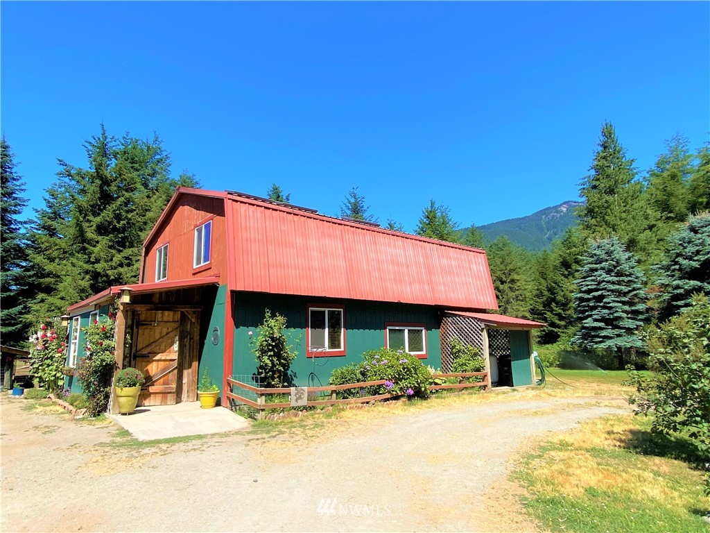 This property is a unique gem. Only 7 minutes to Packwood! 37 mins to White Pass ski resort. This working farm offers a shop which has been converted to a residential space. Kitchen includes beautiful copper countertops. Top floor boasts bedroom, bathroom with metal soaking tub, and a generously sized room currently used as master bedroom. Stained concrete floors downstairs. Beautiful wood finishes in the home. Lovely porch area is currently used as personal garden space. Several animal pens & outbuildings allowed the current owner to successfully raise farm animals. A large shop on the property has been partitioned for storage, office space, and tool storage. Seasonal creek.  Buyer to verify boundaries/usage to buyer's satisfaction.