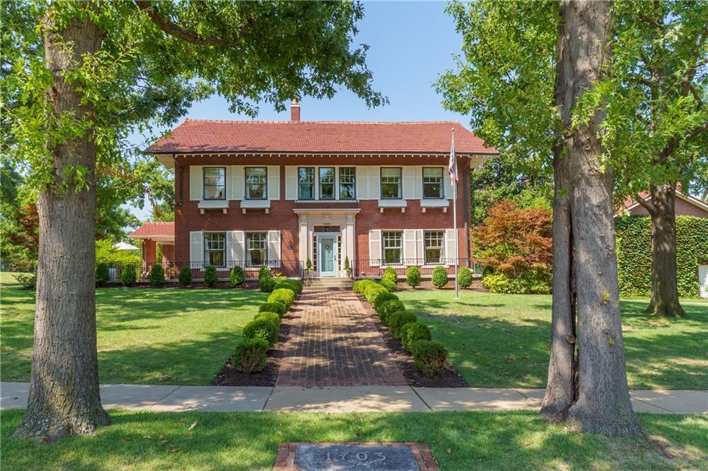 Perfection. Built in 1915 by hotelier Joseph Huckins Jr., this red brick Georgian Revival was constructed of the highest materials of the day. Recognized with the 2014 Restoration Award from Heritage Hills Historical Preservation, Inc.. With a symmetrical, spacious floor plan awash in natural light and original features such as windows, hardware, molding, tile and oak floors, it stuns. In the formal living: original mantel houses a wood burning fireplace and crafted-to-match entertainment center. Elegant Schumacher upholstered dining walls. In the kitchen: custom cabinets, Sub-Zero, tons of storage and commercial range with double oven. Tiled mudroom. Study on second floor landing with original bookcases. Glorious primary suite with dreamy closet and bath. Two more bedrooms with en-suites and access from the fourth bed to a bath. New electrical and mechanicals. Sweeping wraparound porch to survey spacious corner lot. Basement is bonus space. Garage apartment in marketed square footage.
