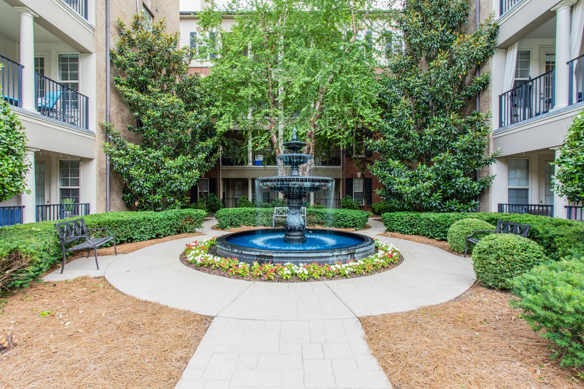 Best unit location in the building! Ground level condo, near the pool and amenities, ideal parking, close to mailboxes. Fireplace, open living, amazing covered porch facing interior and well maintained over the years! Close to retail, interstates and more! HOA managed, beautiful development.