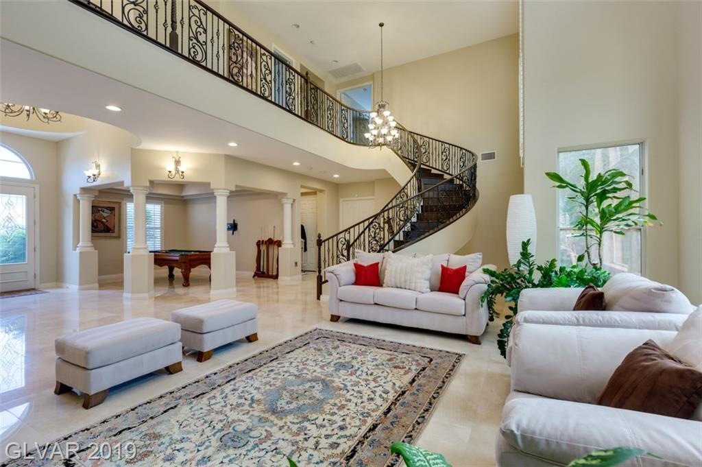 ELEGANT LIVING IN GUARD GATED WESTWOOD COMMUNITY WITH 4 CAR GARAGE! Open concept floor plan offers vaulted ceilings, an abundance of windows and natural lighting & incredible upgrades! Chefs Kitchen has granite and breakfast bar, 4 bedrooms with en-suite baths, bed and full bath downstairs. Stunning master with balcony and fireplace. Gorgeous wrought-iron curved staircase, backyard oasis with pool and spa! Don't miss this hidden gem!