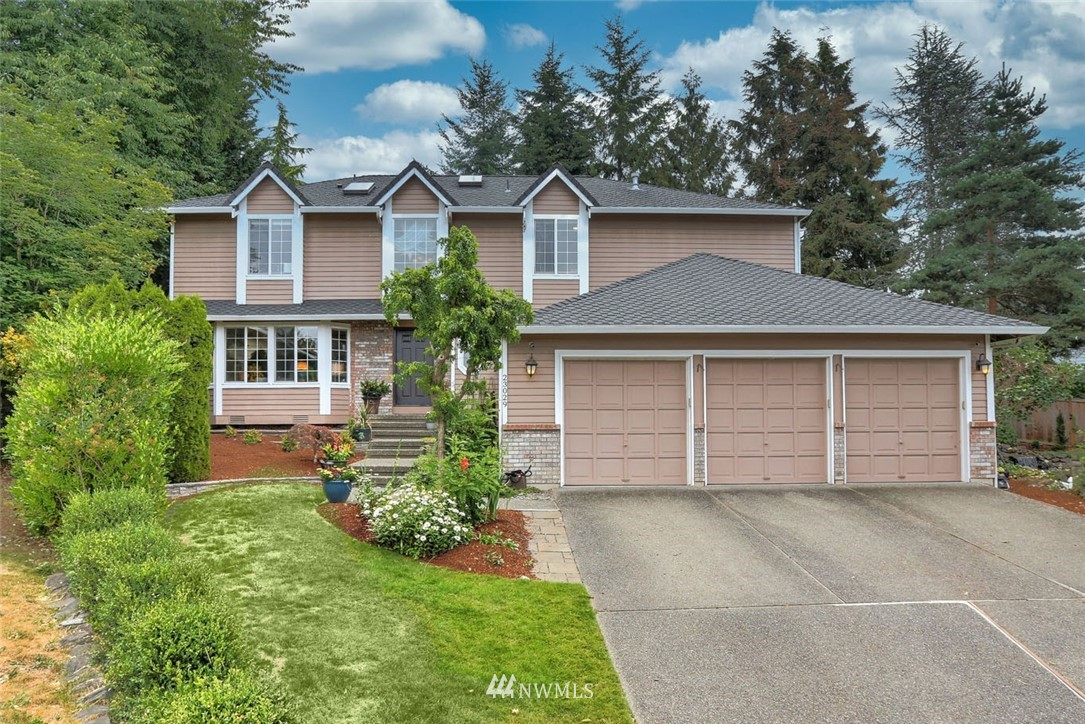 Amazing 5 bed+bonus, 3 bath home! Enter to soaring vaulted ceilings, gleaming hardwood floors & large, light-filled rooms. Updated kitchen w/granite counters, tile backsplash & custom pantry. Spacious primary suite w/gorgeous feature wall &updated ensuite bath. 4 large guest rooms, remodeled guest bath &bonus room on the upper level. Outdoors, you will be enchanted by the incredible patio, spacious yard &fantastic Dr. Seuss inspired play house, waterfall & cabana! Incredible outdoor space will delight the young & the young at heart! Ideally located in one of Maple Valley's most sought-after neighborhoods, enjoy miles of Lake Wilderness walking trails & easy access to Covington, HYW 18, SeaTac airport, major retail, dining & business hubs.