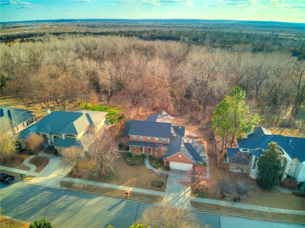 A nature lover's paradise in a coveted Norman neighborhood, Shadowridge.  A professionally built add-on in 2012 on the back of the property showcases incredible views of the greenbelt, or wander outside and have a cup of coffee on the flagstone patio overlooking it as well.  This property is packed with stunning features, some of which include zoned geothermal heating and air, solar power, solar powered water heater, double paned low-e windows, impact resistant class 4 shingles, underground sprinkler system, generator, an interior tornado safe room serving as master closet, Brazilian cherry solid hardwood flooring downstairs that has just been refinished, and numerous perennials and fruit trees.  Garage is extra wide too!  Location couldn't be better too off Lindsey and NW 36th St, just around the corner from all the shopping and restaurants, and with minutes access to I-35. This is one you truly don't want to miss seeing.