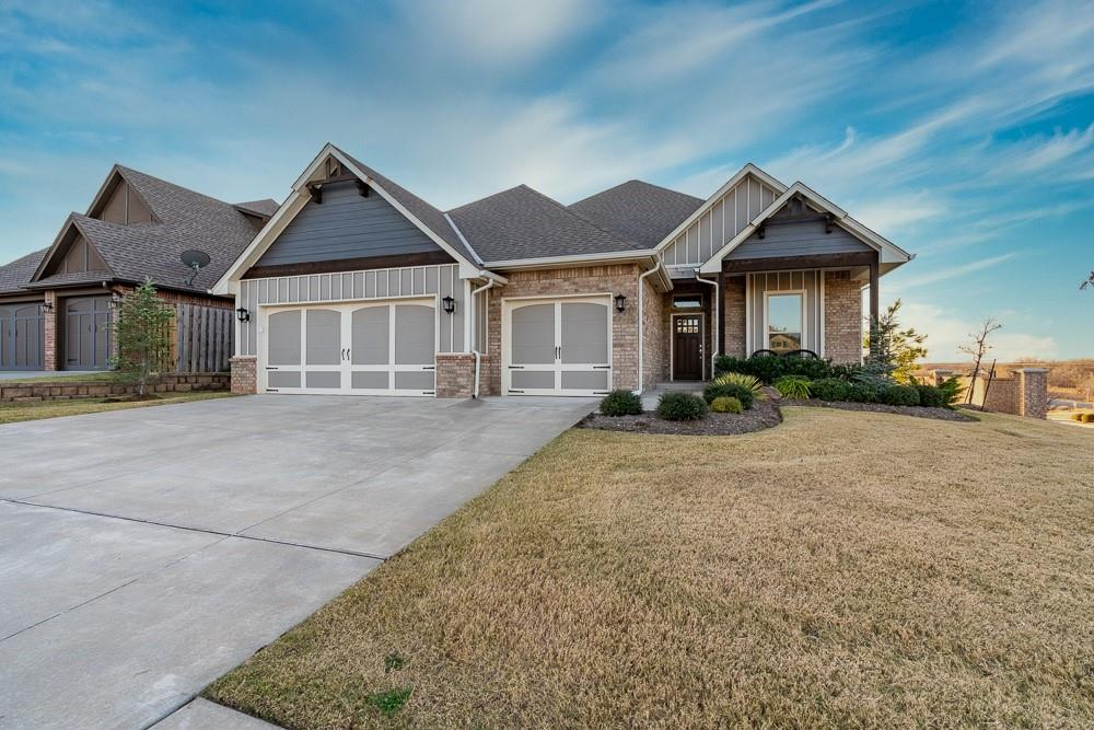 "Be ready to fall in love with this Hampden Hollow corner-lot beauty in Edmond! This home features so many gorgeous custom amenities: barn doors, beautiful shiplap dining wall and fireplace accents, huge kitchen, outdoor living space, & a large versatile secondary living room upstairs & full bathroom. The main living room showcases windows on either side of the fireplace which allow natural light to dance across the room, a stylish & timeless fireplace with stone & shiplap, & wood-look tile. The kitchen is a chef's dream with abundant cabinetry and plenty of countertop space for prepping & serving, stainless double ovens & gas cooktop, & beautiful tiled backsplash- Don't forget about that amazing walk-in pantry. The primary bedroom with a tray ceiling & complete with private en-suite including a separate tub & beautiful walk-in shower. The outdoor living space with a landscaped yard, covered patio & cozy fireplace is a true backyard oasis. Don't miss your chance to call this one ""Home""!"