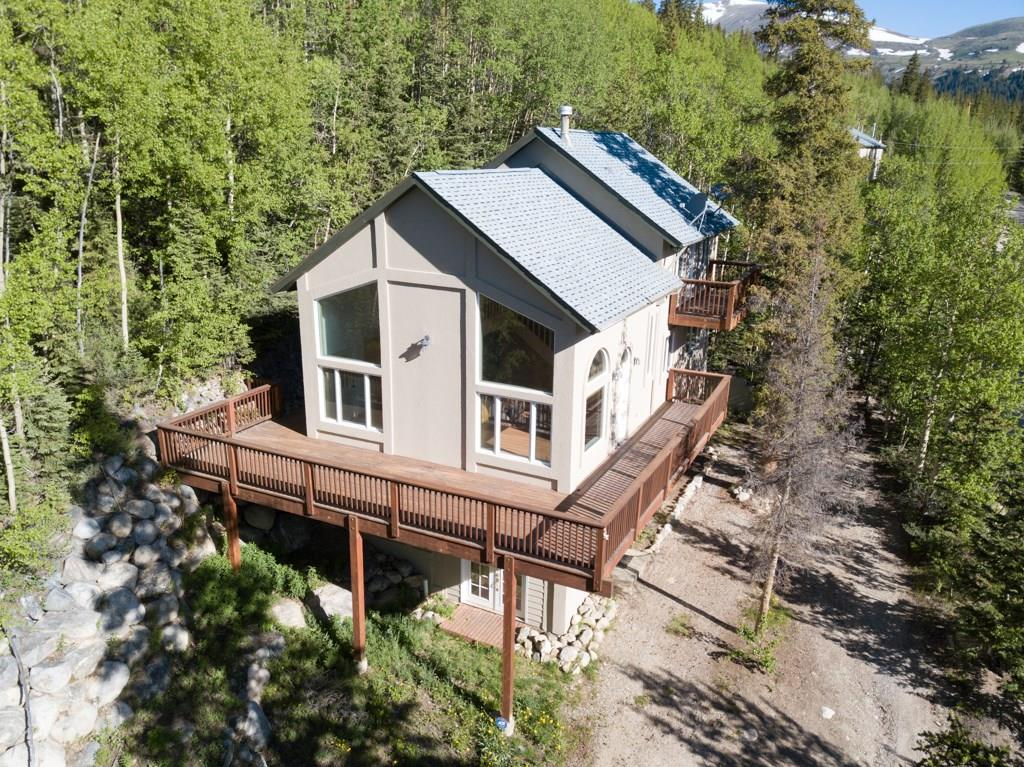 GREAT RENTAL POTENTIAL-2 LIVING/KITCHEN AREAS!  This home sits on a larger Placer Valley parcel w a HUGE OVERSIZED GARAGE! New carpet, boiler, & exterior paint/stain redone w/in the last year.  Relax on the large deck surrounded by healthy aspens while taking in the views. Upper 2 levels have 2 BR/2BA Kitchen, Dining, Great Room & Loft while lower level has an additional 1BR/1BA, Family Room, & Kitchen! Fishing, hiking, biking, x-ctry skiing all within minutes. Only $215/sq! Don't miss it!