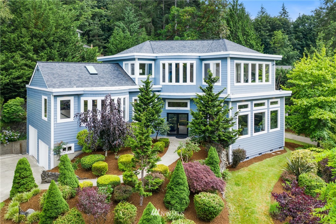 Indulge your imagination & senses with each step through this very special masterpiece.  Unique design elements, extensive use of curves, walls of windows, & inviting spaces both grand & intimate, blanket you like a lux warm embrace.  The grand salon, kitchen & dining rooms are works of art.  Incredible master retreat w/ private den/office w/ fireplace spans the entire upper level.  Cozy family room, separate entry office, outdoor pagoda & gazebo, plus a 4 car drive through garage & new roof.