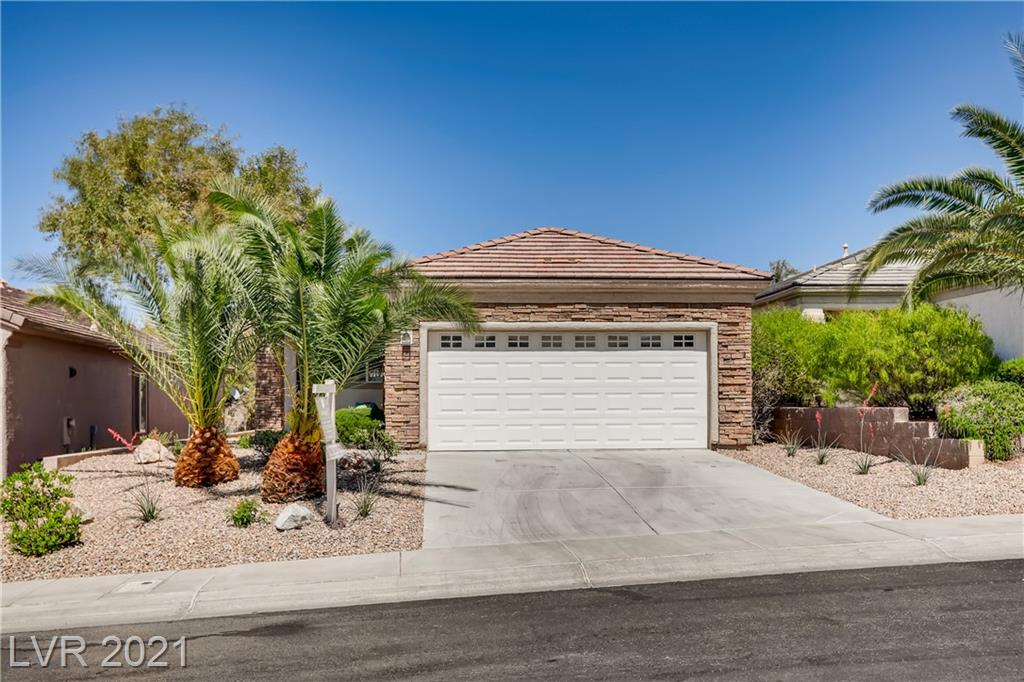 *TURNKEY* MOVE IN READY. Lovely Solera Anthem home in Henderson with beautiful stone front, tranquil, shaded backyard, brand new stainless steel kitchen appliances, new white plantation shutters, new paint and new carpet. LID PAID OFF! Highly desirable Lewis model is situated close to Clubhouse where you can enjoy the amenities of this age-restricted community (55+), such as the Olympic sized pool, state of art exercise equipment and many activities for active adults!