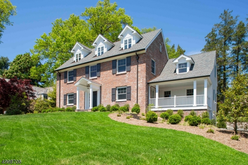 Style & Sophistication are the hallmarks of this totally renovated 5 bedroom, 5.1 bath Colonial in the prestigious Northside of Summit, blocks to town, NYC train & top-rated schools. Imagine entertaining in this elegant home. The front to back family room with coffered ceilings & fireplace has French doors to covered Porch which opens to a spacious patio. The eat-in kitchen is a chef's dream with marble counters, high end appliances & pantry.  The formal dining room, office, mudroom, 2nd covered porch & powder room complete 1st floor.  5 beds, 4 full baths are nestled on 2nd & 3rd levels. The master suite features 2 walk-in closets & ensuite bath. The basement features rec room, laundry, mudroom, full bath, access to 2-car garage. A private & expansive yard complete this amazing home.