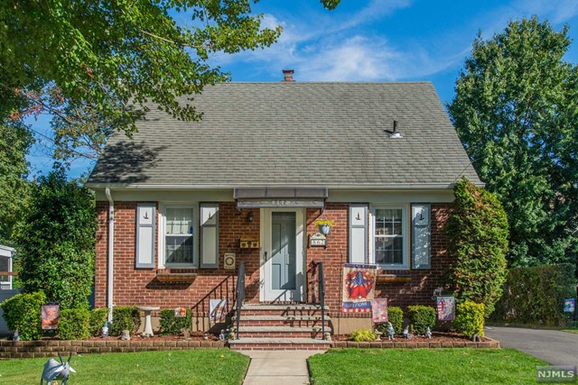 Move-in-ready, attractive brick cape, on prime street in desirable Maywood! Features include 3 BRs, open living rm & dining rm w/hardwood flrs, updated country kitchen w/new appliances, backsplash, pantry & rollout drawers, updated bathrm w/Bathfitter shower, large basement w/high ceilings (easy to finish!), great backyard w/large deck & private, flat, fenced yard! 200 amp upgraded electric, Central AC, new hot water heater & furnace, even in-ground sprinklers! All new kitchen appliances, & washer & dryer included! Oversized 1 car garage w/long driveway too! All this & walking distance to schools, parks, NYC bus & the Bergen Town Center Mall w/Target, Starbucks, Whole Foods & more! Well maintained & a Must See! Dont Miss this one at a great price!