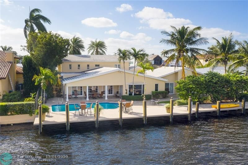This updated Sunrise Key home has it all with 4BR/4.5 baths, office, billiard room, 2 car garage, solar heated pool and 105' of deep water frontage with Rebuilt Seawall/New Composite Dock. Enjoy over 4,600 SF of A/C space, spectacular great room with open beamed ceilings, substantial master suite with two walk in closets, generous bath and even a Sauna. This home offers a Classic Tropical Vibe both inside and out including your beautifully landscaped oversized lot. The residence is located in the prestigious Sunrise Key island community consisting of only 75 waterfront homes w/ police patrol and one gated entrance and offers deep water dockage to easily accommodate your 85' yacht.. Minutes to downtown, fine shops/dining, Whole Foods, Fresh Market and the Airport.