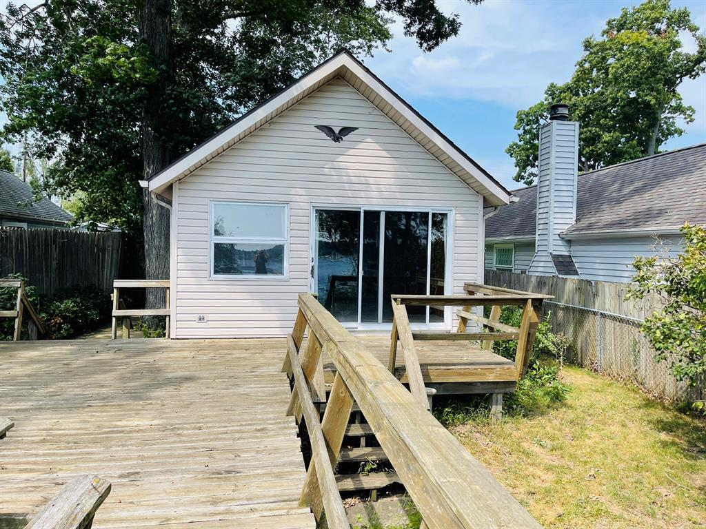 Private Ackerson Lake home on a dead end street.  Ranch home with a spectacular view! Full basement, detached garage and large deck.