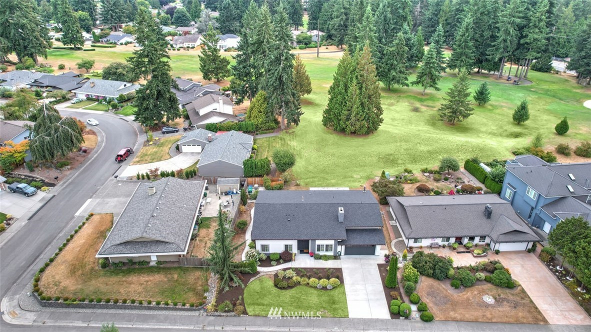 Adult Family Home on golf course! Licensed for 6 beds. Selling with all furnishings, appliances, fully equipped kitchen including 3 refrigerators, 2 sets of washer/dryers and all equipment such as 4 hospital beds, 1 wheelchair, 1 wheelchair tilt in-space, 1 hoyer lift, call system, standby generator, & all supplies. Up to code & ready for business! 4 beds on main floor-2 shared rooms (one shared room has private bathroom). 2 private rooms. 3 beds upstairs. 4 car tandem garage. $50k in recent improvements. Pre-inspected. Quality upgrades-Brand new roof, plumbing, electrical, windows, flooring, bathrooms, tankless water heater, 2 furnaces, driveway, siding, exterior paint. Lovely gardens & covered patio. Peaceful setting in desirable location