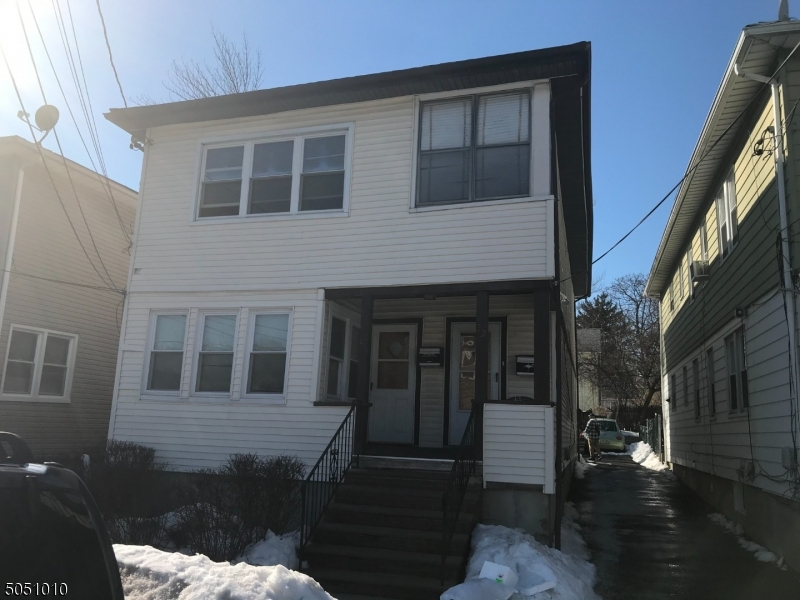Good size 2 family with driveway for 4 cars. Vinyl sided, seprate utilites.  Both furnaces and hotwater heaters less than 2yrs old. Near NYC transportation.