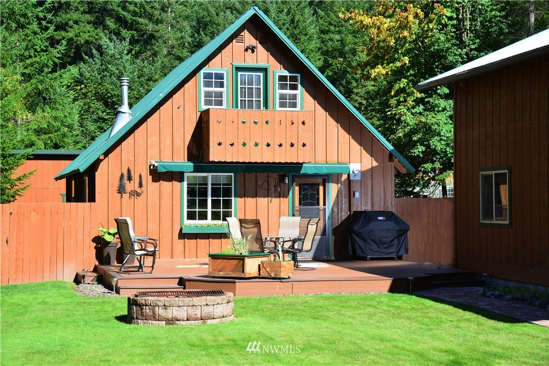 This cabin is meticulously maintained.  Updated everything over the last 8 years including foundation, septic, electric, interiors. New 22 x 39 garage plus workshop.  Inground sprinkler system, raised bed gardens, impeccably landscaped, fenced.  Lots of storage.  High Valley community features pools, 9-hole golf course, clubhouse and walking trails.  Located just minutes from Mt. Rainier National Park, White Pass Ski Area, Mt. St. Helens & the Gifford Pinchot National Forest.  This one is a gem!