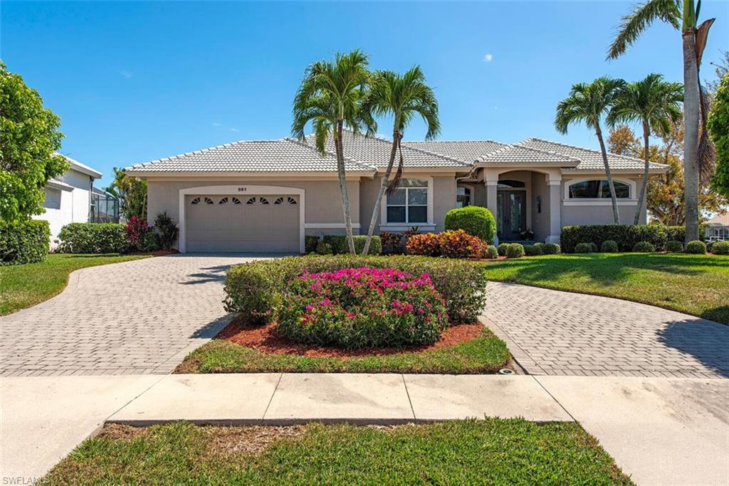 Welcome to Paradise! ENJOY 140 feet waterfront! No need to compromise on this stunning home. Built by legendary local builders Slocum Christian. Situated on a prime highly desirerable oversized Southern exposure lot on wide intersecting canals rare 140 feet waterfront. The view is breathtaking as you enter the front door.  Enjoy the inviting open flow floor plan with volume ceilings and custom upgrades throughout in this meticulously kept home. Designed with entertaining in mind , the Great Room flows seamlessly into the kitchen and dining area. Floor to ceiling sliders completely open to fabulous screened lanai to extend your living space with outdoor kitchen, pool, spa and shower.  Privacy abounds as well, the guest bedroom wing can be separated from open areas by sliding pocket doors. The master bedroom suite is on opposite side of home than guest bedrooms. Turn key just bring your boat, large dock with amenities and great fishing. Three bedrooms and three full bathrooms. Perfectly located in the center of Marco Island minuets from everything the Island has to offer.