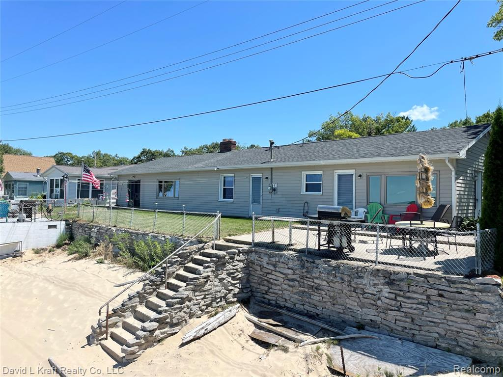 """LAKE FRONT RANCH DUPLEX: Great sandy beach with 90.06' of Lake frontage. 6 bedrooms, 2 baths. (3 bedrooms, 1 bath for each 1/2 of duplex) Beach Garage with concrete patio above in front of East 1/2 of duplex. West 1/2 of duplex rented out at $900. per week with a great Concrete patio. Windows replaced 2 & 5 years ago. Vinyl siding added prior to that. Shingles replaced 2016. BR#5 9' x 11', BR#6 8'-9"""" x 11'. What a great location and beach area. Has beach even during the highest lake levels. Possession after summer rental season."""