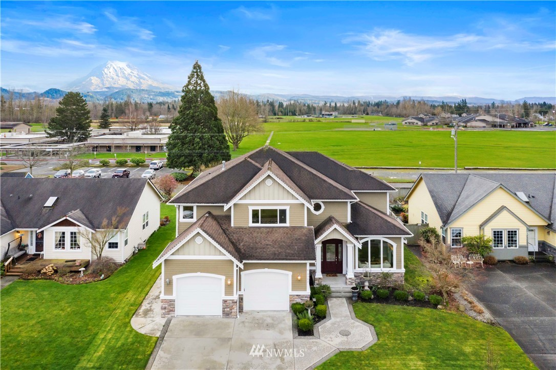 UNOBSTRUCTED MOUNTAIN VIEW! This expertly maintained home boasts casting views of soccer fields, Mt Rainer & more. Walk into 20' vaulted ceilings & grand stair case. Great open concept offers a Chefs kitchen that feat granite, oversized island, custom cabinets w/crowned molding & SS VIKING app, overlooks the spacious family room w/gas FP. Office & formal living room on main. Huge laundry/mud room w/laundry shoot. Master w/Mt Rainer views & on-suite 5-pc bath w/a jetted tub, double vanity & double headed shower + rain feat. Jr Master suite + oversized bedrooms & large loft area. Outside feat a huge covered patio & sports court w/full size adj glass basketball hoop. Enjoy A/C in the summer months & walk out to a seemingly endless grass field.