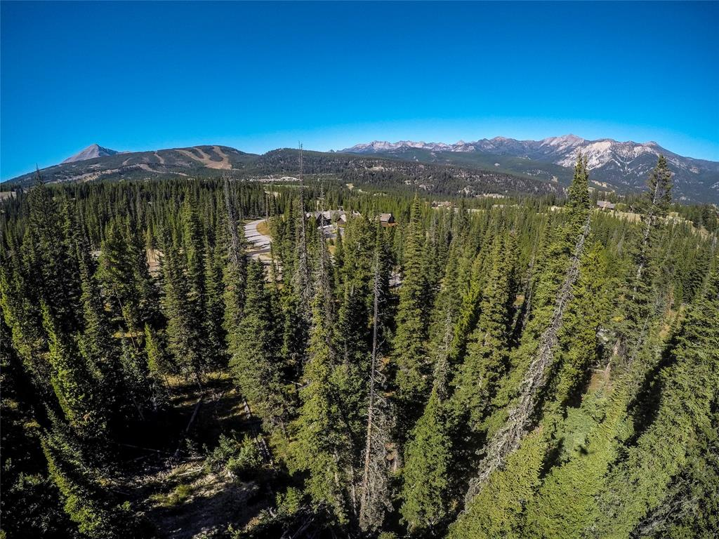 Enjoy stunning and rare panoramic views of both the Spanish Peaks and Lone Peak from this old-growth tree laden lot. At just under three acres, and located on a infrequently traveled street, this lot is perfect for your future Montana dream home. The homesite is centrally located between every amenity Spanish Peaks members hold dear; Minutes to Town Center and even closer to the future Montage Hotel, and Spanish Peaks Clubhouse. There you will find world-class dining, ski-access to Big Sky Resort, a Tom Weiskopf golf course, fitness center, pool, activities for kids, and more. Membership to the Spanish Peaks Mountain Club is a requirement with purchase.