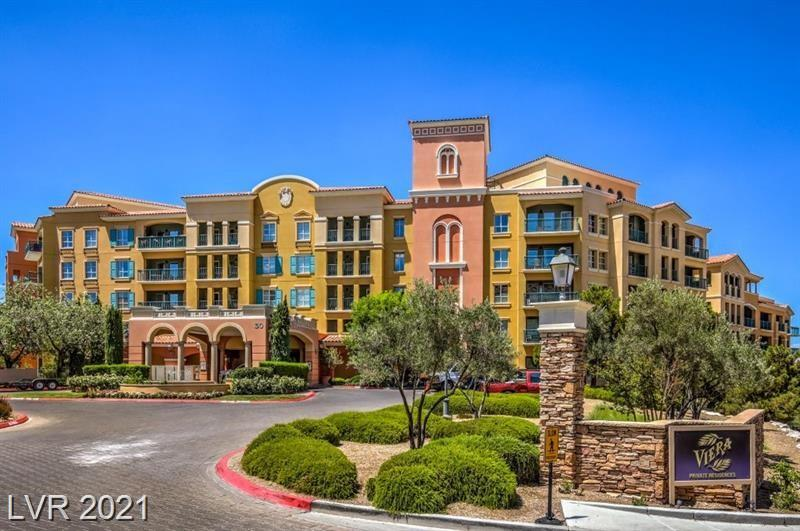 HIGHLY SOUGHT AFTER LAKE LAS VEGAS CONDO-PROFESSIONALLY DECORATED THROUGHOUT, INCLUDES ALL FURNISHINGS, APPLIANCES, DECORATOR TOUCHES AND ITEMS, KITCHEN CUSTOMIZED WITH ALL BLACK APPLIANCES, TRAVERTINE STONE FLOORING, STONE BALCONY FLOORING, CUSTOM PAINT AND DECOR, GRANITE COUNTERS, MIRRORED ISLAND AND SO MUCH MORE!  MOVE RIGHT IN, JUST BRING YOUR SUITCASE!  TURNKEY UNIT!