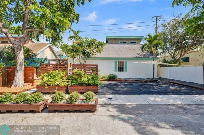 Beautiful and Rare Open Concept 3/2 Townhouse, Premium Location in Rio Vista at the Heart of the Ft Lauderdale! This Home Features an Outdoor Courtyard and Seating Area, Interior Balcony Style Loft Connected to Upstairs Master Bedroom, Sky High Vaulted Ceilings with Cedar Beams, Lots of Natural Light, Ring Doorbell System, Brand New Pavers and Front Yard Landscaping, Custom Designed Cedar Planter Boxes with Jasmine Plants, Freshly Painted Exterior, Beautiful Blooming Orchid Tree, Impact Glass Windows and Hurricane Shutters, Large Parking area with 4 Spaces, SS Appliances, Solid Red Oak Kitchen Cabinets, High-End Marble Countertops in Bathroom with Walk In Shower, Lots of Closet Space, W/D in Unit, Storage Shed, Den can be Converted to be a 3rd Bedroom. Close to Everything! No HOA!