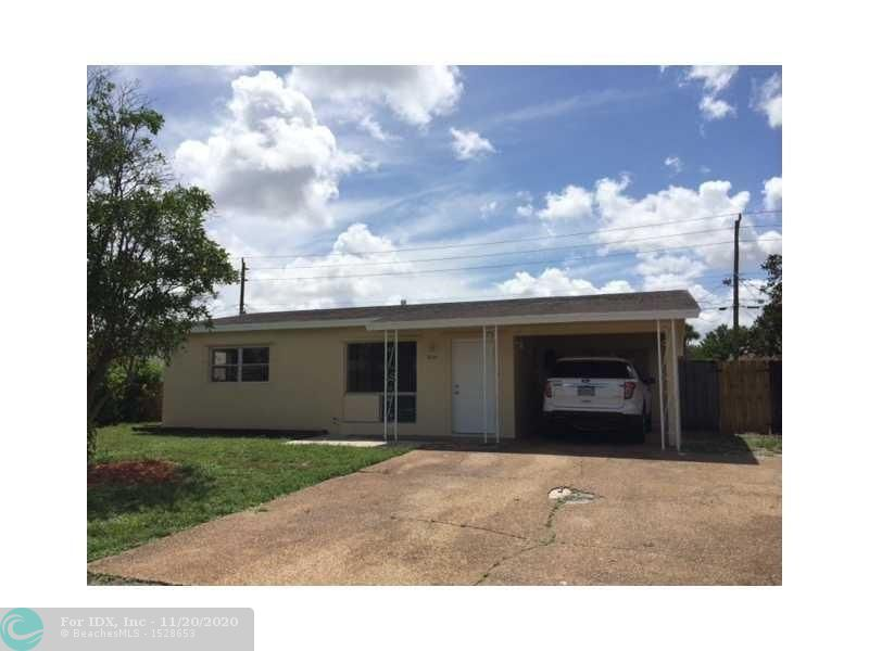 Large 2 bedroom 1 bath single family home with carport and large yard.
