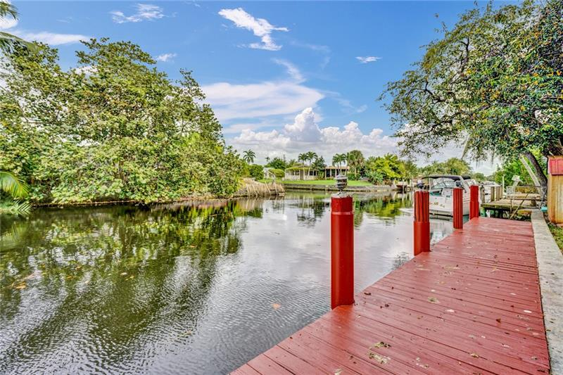 CALLING ALL BOATERS!! DEEP WATER / OCEAN ACCESS / DOCK / GARAGE ...This home has it All - DOUBLE IMPACT WINDOWS & DOORS, NEW KITCHEN W/STAINLESS APPLIANCE PACKAGE, 3 FULL BEDROOMS + SEPARATE OFFICE. THE KITCHEN OPENS TO THE FLORIDA ROOM & OUT TO THE SCREENED POOL AREA. AN OVERSIZED YARD (11,380 SQ FT) HAS PLENTY OF ROOM FOR TOYS, SHEDS, PARTIES...SO BRING IT ON, IT'S THE PERFECT HOME FOR ENTERTAINING! A CIRCULAR DRIVEWAY ALLOWS ROOM FOR BOATS, RV'S & PLENTY OF PARKING.  MORE EXTRA'S INCLUDE IS A SEPARATE LAUNDRY ROOM AND 1 CAR GARAGE , UPDATED ELECTRICAL, AND NEWER AC SYSTEM. THIS AREA IS CLOSE TO HIGHWAYS, AIRPORT, BEACHES, IT'S A VERY CONVENIENT LOCATION. COME CHECK IT OUT BEFORE IT'S GONE!