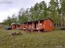 Off the grid pole barn .Wonderful  assessor building  in the woods with a lot of space around it.  Near great hunting and fishing areas all around for you out doors person that loves to play. (Hunt, fish, bike, hike, atv, horse back ride)  All fenced, backs up to BLM.     Built as a pole barn.   Well 2 GPM, septic, and a little solar.  Also has a small cistern.  Wired but not hooked up to electric.   lots equals 5+acres with cabin/pole-barn on one lot.