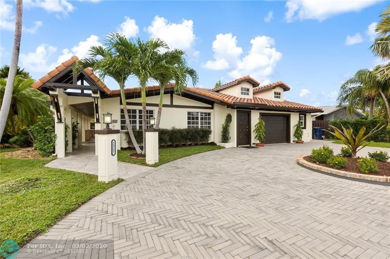 Newly Waterfront Renovation in East Wilton Manors. 3 Bedrooms 3 full Baths. 2 Master Bedrooms with en suites. 70 foot on water plus a Boat lift. Newer roof, circular paved driveway Move in ready. Bar area over looking the water. Great home for entertaining.