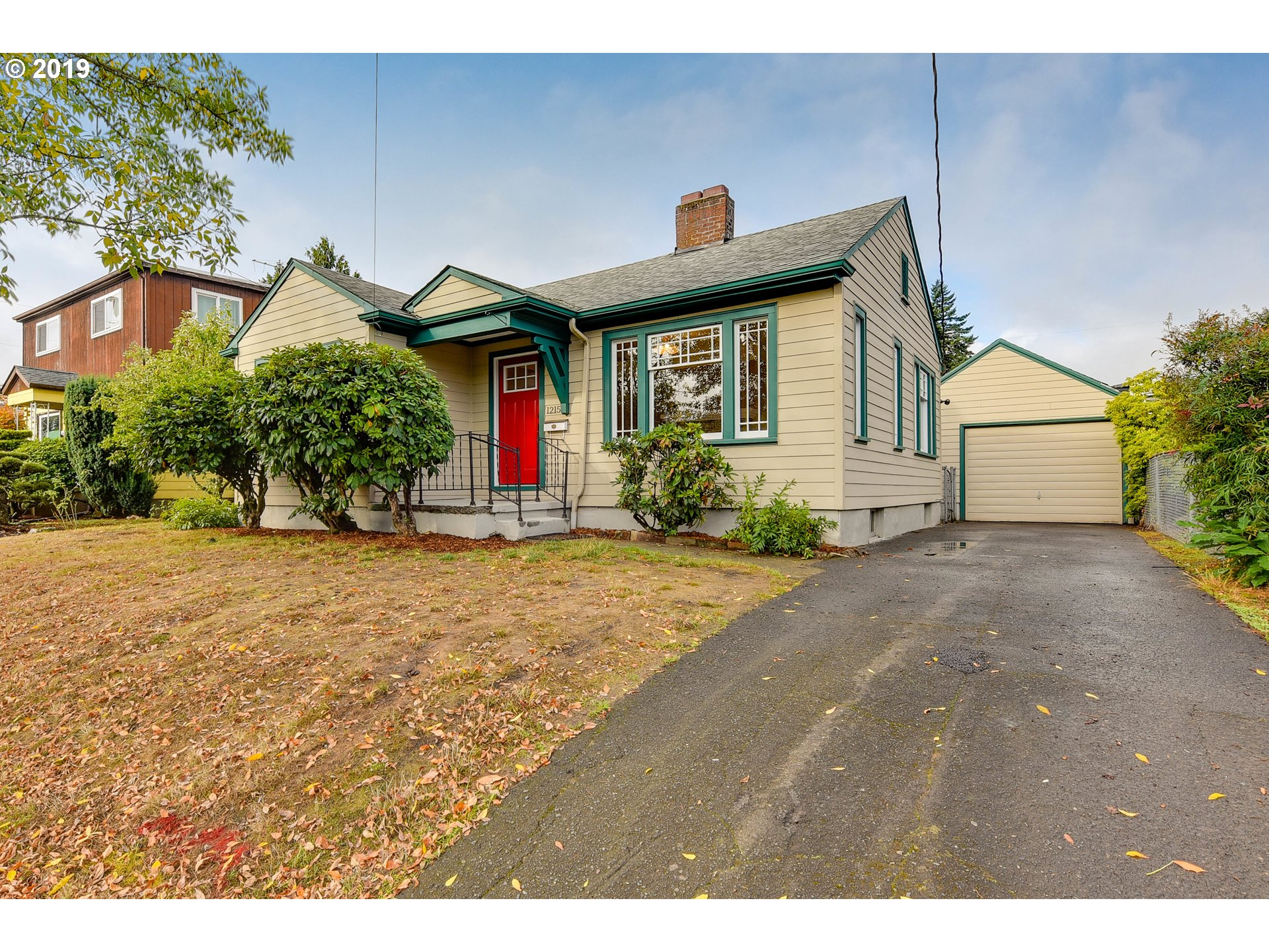 Very sweet 1929 Bungalow with vintage charm intact and lots of upgrades! New paint, finished hardwood floors, light & bright interior w/ fireplace, dining area & 2 large bedrooms! Loads of storage in basement, rare attached BONUS STUDIO SPACE approx 350 sq ft with hardwoods, big windows and ADU potential. Detached garage, big driveway and large yard