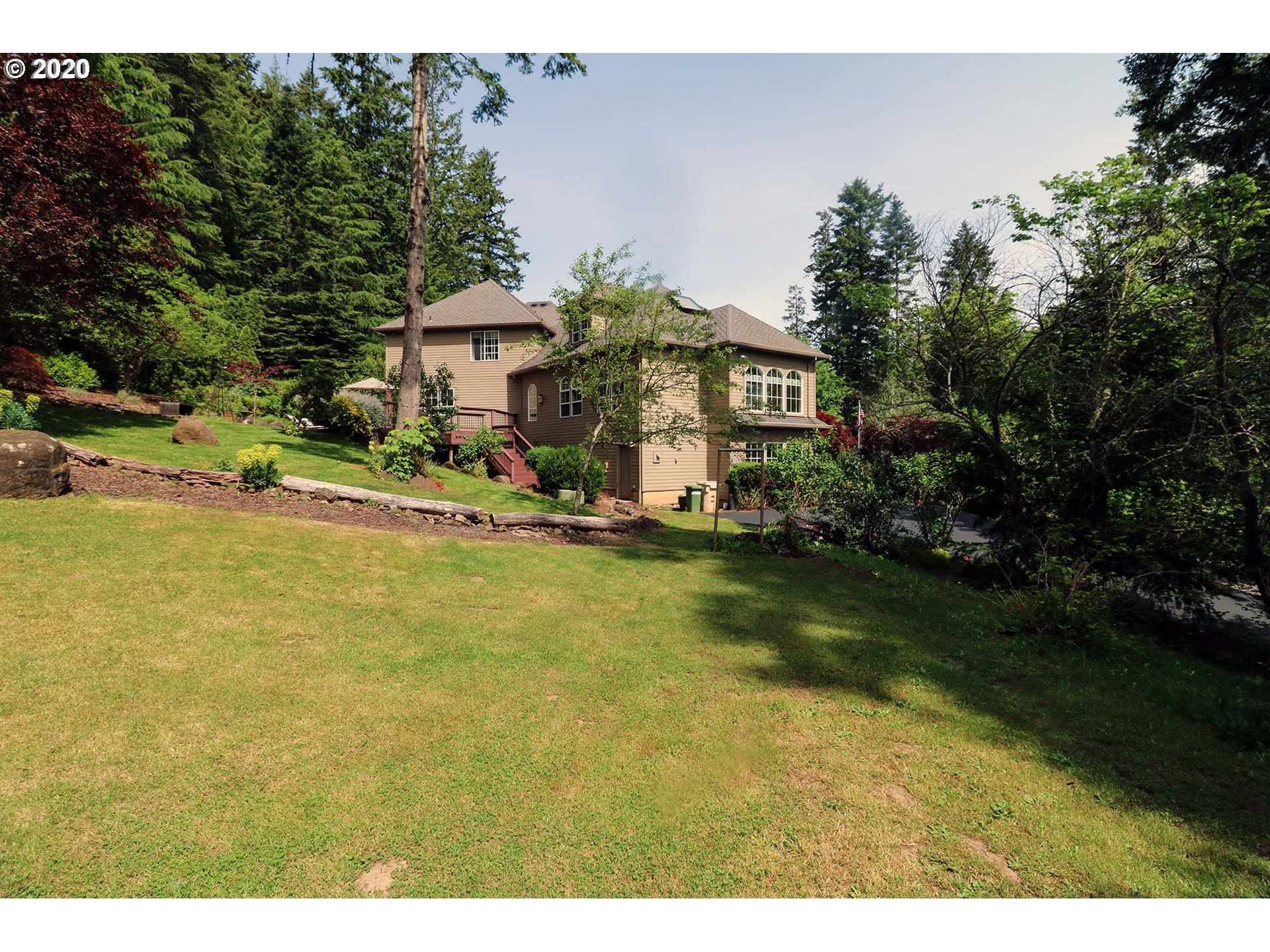 Incredible location close to Portland, yet surrounded by gorgeous farmland & forest. House sits on a private acre w/neighborhood tennis, river access & boat launch. Walls of windows bring in natural light w/spectacular 2 story windows in living room. Gourmet kitchen has hardwood floors & gas cook island w/huge deck for entertaining. Master on main has gas fireplace-garden tub-walk in shower & huge closet. Upstairs family room has soaring vaults & skylight; main floor bonus is 962SF See 2 videos