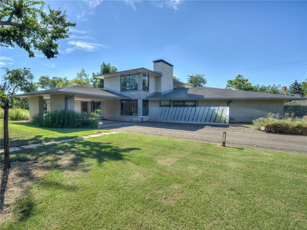 """PRIME LOCATION in the HEART of NICHOLS HILLS. ARCHITECTURAL DIGEST WORTHY! TRUE Mid-Century Modern tucked away on 1 acre lot. Thoughtfully RESTORED to itsoriginalglory. An Architect's DREAM! SUPERBLY CRAFTED Residence features: walnut paneling in living and hallway with hidden storage, Zebra wood on enclosed bar, glass walls with 3""""statement"""" fireplaces, and LUXURY fixtures throughout. Living space is a magnet for social gatherings. Danish/Modern Kitchen is a Culinary Work of ART.Receding glass doors off main living lead to EXPANSIVE backyard with outdoor kitchen, fire pit and picturesque fountain. Property is sited on PRIVATE, corner lot away from the street and encircled with a wall of evergreen landscaping allowing for complete privacy for entertaining. All bedrooms are ensuite and generously sized. You will LOVE the Main Suite with fireplace, """"spa like"""" bathroom, and private access to outdoorretreat. TRANQUILITY and ARTful LIVING found HERE!"""