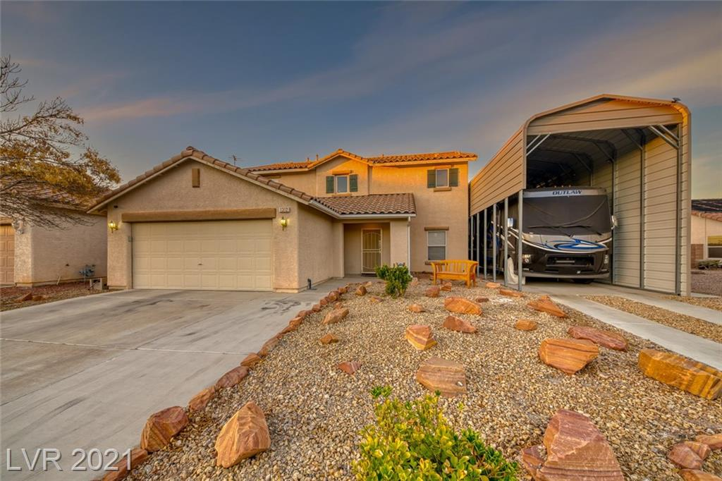 2509 sq ft, 4 bedroom, 2 1/2 bath, 2 car garage w/covered RV parking with balcony off master with unobstructed views of Strip and Mountains and only a landscape HOA for walkway across the street (so no real HOA on the property).