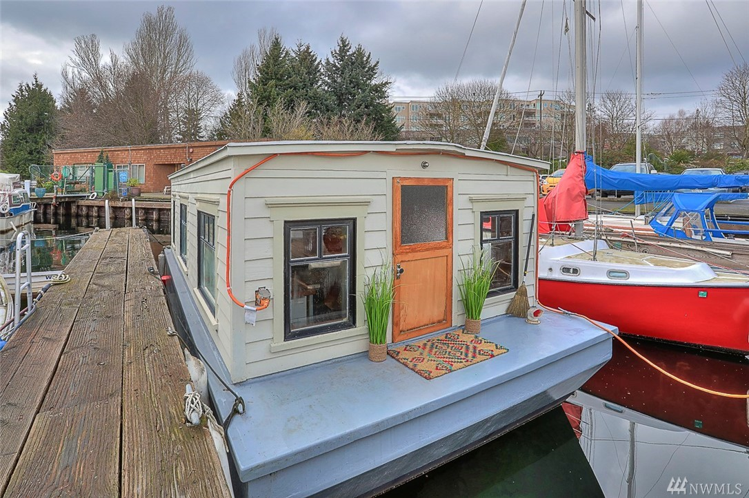 "Charming, artistic studio houseboat on Lake Union AND you OWN your moorage! This is a legal, registered floating on water residence in condominium-owned moorage in a great, well-managed waterfront community. Monthly dues are low-$363! This ""floating cabin"" was lovingly rebuilt in 2012 and features craftsman wood detailing & whimsical touches throughout. Live full-time, weekends or rent out (minimum 30 days). Pet-friendly! Next to bike trail, Gas Works Park & minutes to U of W, Fremont, SLU & DT."