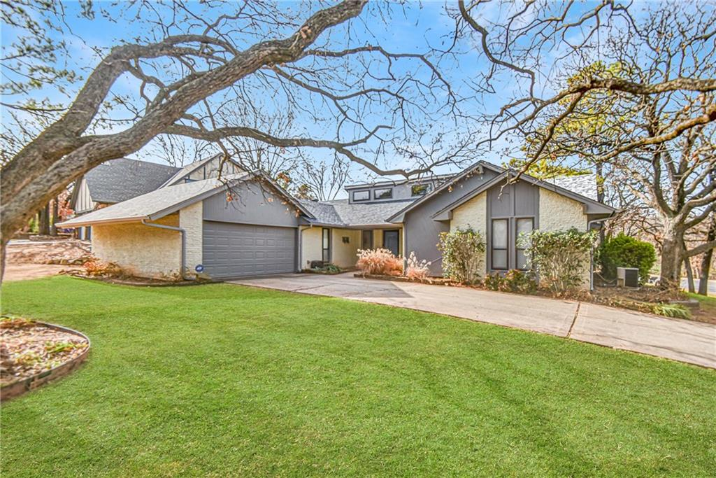 This unique mid century designed Edmond home is sure to win over your heart! The spacious living room features a stone fireplace and tall ceilings to make the space look even larger. The sprawling master suite includes its own private en suite with modern glass front barn doors, a granite vanity, and a large walk-in closet with built-in storage. The secondary bathroom offers tons of added storage and a double vanity while other great features in this home include the large windows and second dining space. Outside, mature trees and a decorative pond create a gorgeous landscape with two covered patios to enjoy a relaxing evening outdoors.