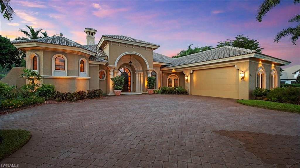 This Tuscan Architectural Style Masterpiece sits just as majestically in the day as it does in the evening hours, on a lavish multi-dimensional landscaped corner lot. You will find extensive attention to detail throughout this custom-built home, beautiful textures, materials, and finishes that create a sense of timelessness. This home is designed for entertaining friends and family while providing a casual and inviting lifestyle which includes two bonus rooms, as well as an exquisite master suite. Beautiful soaring decorative tray and coffered ceilings. Extra features include two 500 gallon tanks to support a total 2021 house generator. You'll love having plenty of larger storage options, a three-car garage with a golf cart garage door entry. The outdoor area includes an outdoor kitchen and is complemented by a heated pool and spillover spa. Located within minutes to gulf beaches, shopping, and numerous destinations. Showings by Appointment Only.