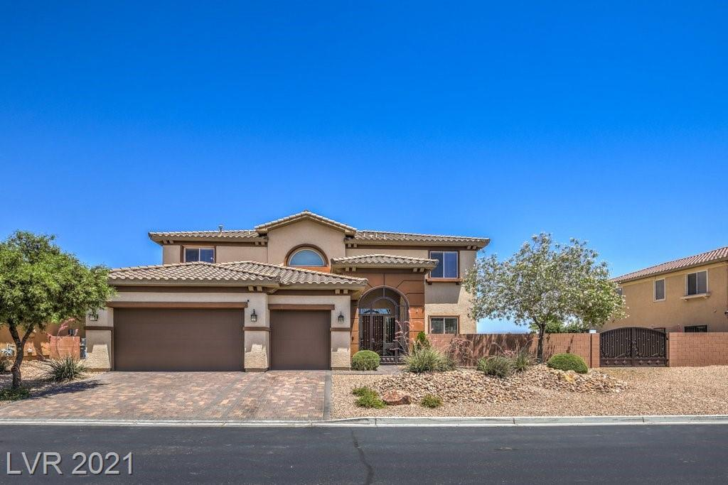 """This beautiful 5 bedroom, 3 full bath home is move in ready and full of upgrades! Offering 4,036 sqft of living space and a 13,068 sqft large lot! Beautiful pool and spa installed in Nov. 2020! Pool/spa installed with smart home controls that can be used from an app on your phone! Deep end of pool reaches 9ft deep, keeping the water cool on those hot summer days. Relaxing spa to come home to after a long day. Custom kitchen with center island cooktop, beautiful backsplash, and raised cabinets. First floor bedroom with attached bathroom. Primary bedroom with attached balcony offering mountain and strip views. In the heart of Mountains Edge, this home shows the meaning of """"pride of ownership""""."""