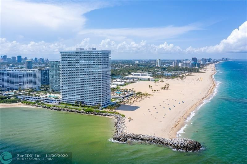 Spectacular ocean and coastal views from this spacious north facing residence in prestigious Point of Americas II. 2nd bedroom is opened as a den which expands your living space.  Newly updated lobby and social areas.  Amenities include 2 heated pools, restaurant, guest hotel rooms, 24 hr security and cabana service. Close proximity to airport, restaurants, Las Olas and shopping.