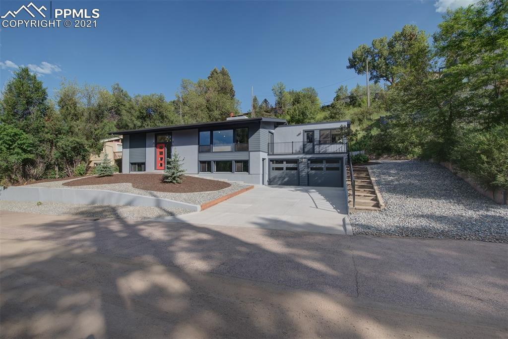 This custom, detail-rich, completely remodeled home is sitting in Lone Pine Heights & only 5 minutes away from I-25 and 7 minutes from downtown.4 beds,3 baths,2 car garage,2 decks & much more.This home is impeccably designed with an outstanding list of amenities to include two Masters one with private deck,huge 7*10 walk-in closet & more.Kitchen with custom cabinets,top of the line appliances & quartz counter tops throughout.Two full wet bars!Get cozy & stay warm near any of the two fireplaces.Read supplement remarks also!
