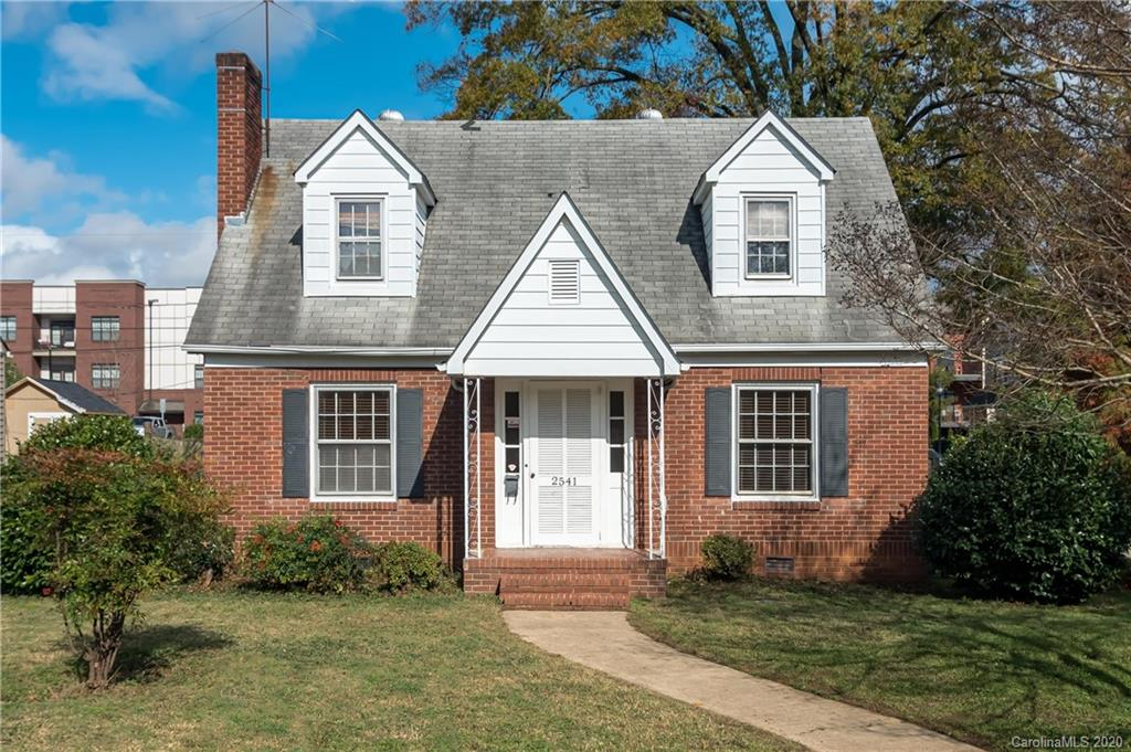SO MUCH POTENTIAL for this Cute 1.5 story brick home on a corner lot in the highly desirable Chantilly neighborhood, adjacent to NODA/Plaza Midwood, close to entertaining and restaurants. Some TLC is needed to make it your own!  Stylish features include arched doorways, fireplace ( sold as is with no known problems)  hardwoods throughout and marble bathroom tiled floors.  Foyer leads to a spacious living room and dining room area.  This house boasts a bedroom & bathroom down, hardwoods staircase leads to 2 large bedrooms upstairs & 1 bath.  Unfinished basement.  Fully fenced backyard and detached garage ( sold AS IS )  increases privacy. Flat backyard is great for entertaining .   House is owned by investors and being sold AS IS .. List Price reflects room for TLC ..  Please submit all offers by Sunday, November 15th at 6 pm.